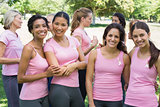 Female volunteers participating in breast cancer awareness