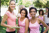 Volunteer and participants at breast cancer campaign