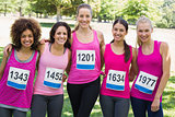 Confident women participating in breast cancer marathon