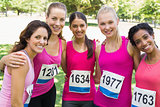 Confident female participants of breast cancer marathon