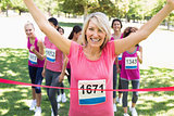 Happy winner of breast cancer marathon race