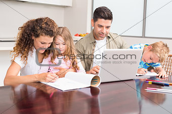 Cute young family at the table