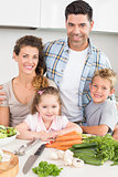 Smiling family preparing vegetables together