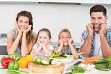 Cheerful family preparing vegetables together