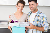 Cheerful woman holding many gifts from her partner