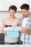 Surprised woman holding many gifts from her partner