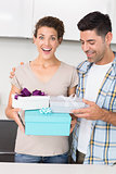 Shocked woman holding many gifts from her partner