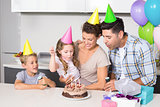 Happy young family celebrating a birthday together
