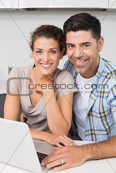 Attractive couple using laptop together