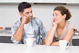 Fed up couple having coffee looking at each other
