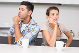 Unhappy couple having coffee not speaking