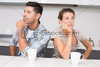 Unhappy couple having coffee not speaking