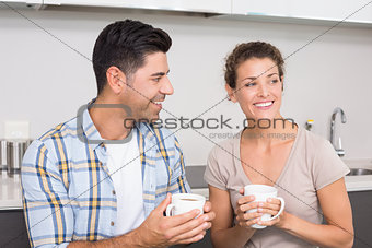Attractive couple sitting having coffee together
