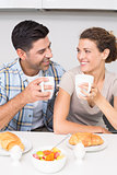 Attractive couple sitting having breakfast together