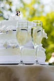 Close-up of wedding cake and champagne flutes