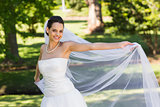 Portrait of a smiling beautiful bride in park