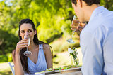 Couple with champagne flutes sitting at an outdoor café