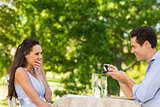 Man proposing woman at an outdoor café
