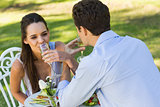 Couple drinking champagne at outdoor café