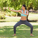 Healthy woman standing in fighting stance at park