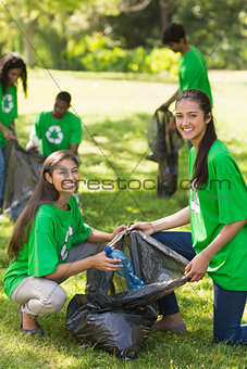 Volunteers picking up litter in park