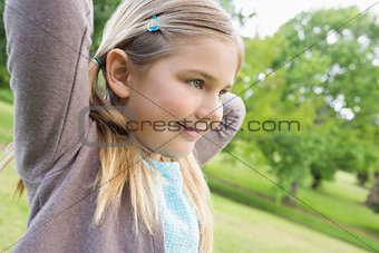 Cute smiling young girl at park
