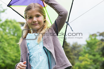 Portrait of cute young girl with a kite