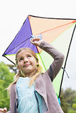 Low angle view of cute girl with a kite