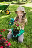 Smiling girl engaged in gardening