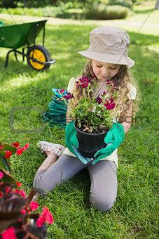Little girl engaged in gardening