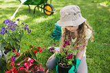 Little young girl engaged in gardening