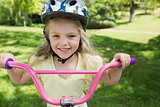 Close-up of little girl on a bicycle at park