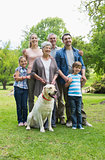 Happy extended family with pet dog at park