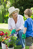 Grandmother and grandson engaged in gardening