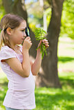 Girl examining leaves with a magnifying glass at park