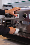 Barista making cup of coffee