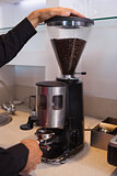 Barista grinding coffee beans
