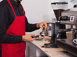 Barista pressing the coffee grounds