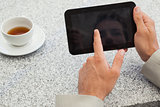 Businessman using small tablet at table