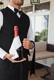 Waiter holding magnum of champagne