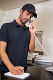 Pizza delivery man taking an order over the phone