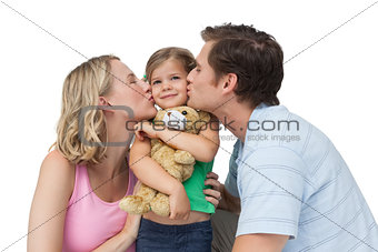 Parents kissing their little girl on her cheeks
