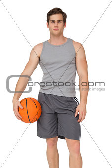 Fit man holding basketball