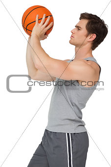 Fit man holding basketball about to shoot