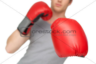 Athletic man wearing red boxing gloves