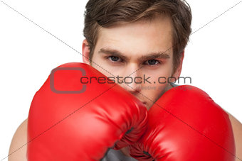 Fit man wearing red boxing gloves