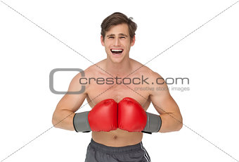 Fit man wearing red boxing gloves and shouting