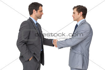 Smiling business team shaking hands