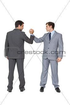 Smiling business team putting hands together