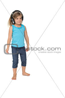 Cute little girl listening to music